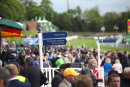 Crowd & signposts at Chester races, May 2014.
