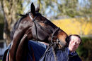 Sprinter Sacre gives trainer Nicky Henderson a kiss.