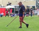 Fence Judge Chris Trim retrieves another horse shoe