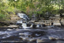 01M-4639 Catrake Force Lower Falls Meeting the River Swale in Autumn Yorkshire Dales UK.