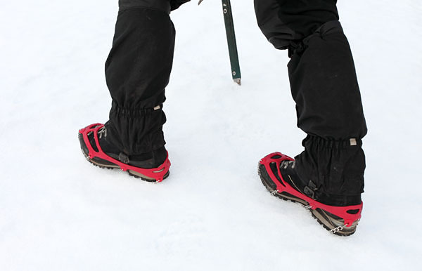 03D-0775 lose up View of a Pair of Kathoola Microspike Crampons in Use on Snow UK