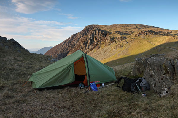 04D-7844 Lightweight Backpacking Tent on the Lower Slopes of Dale Head with the Mountain of High Spy Behind Lake District Cumbria UK