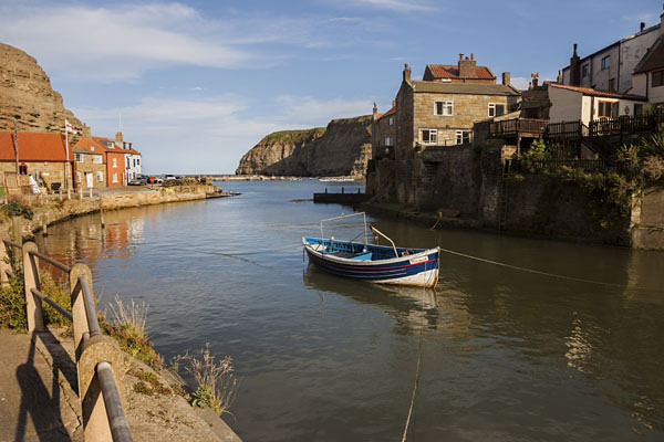 05D-5859 The Fishing Village of Staithes and its Harbour at High Tide Viewed from the Bridge Over Staithes Beck North Yorkshire UK