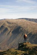 06-2225 Hill Walker enjoying the view from Red Screes, Lake District, Cumbria