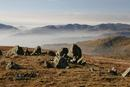 06-2238 Natural Stone Circle on Red Screes with the view west over mist filled valleys, Lake District, Cumbria