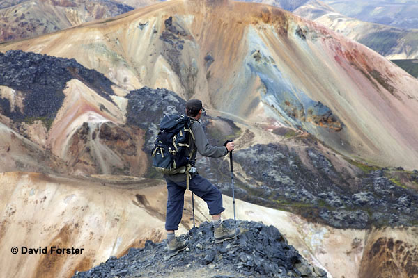 06D-1672 Hiker on the Mountain of Blahnukur Looking Towards the Colourful Brennisteinsalda Volcano Near Landmannalaugar Iceland