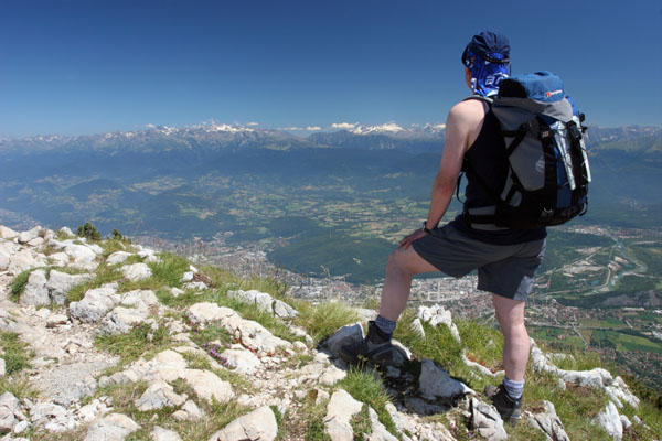 07-2190 Mountaineer on the Summit of Le Moucherotte Above the City of Grenoble Looking East Towards the Alps