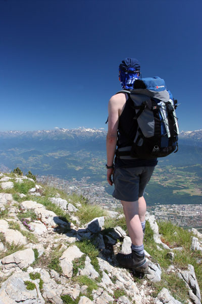 07-2191 Mountaineer on the Summit of Le Moucherotte Above the City of Grenoble Looking East Towards the Alps.