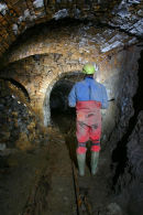D9 129 Caver in Mine Passage Brownley Hill Mine Nenthead Cumbria