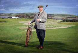 Golfer with hickory clubs