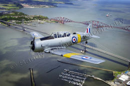 WW2 fighter over the Forth Road and Rail Bridge